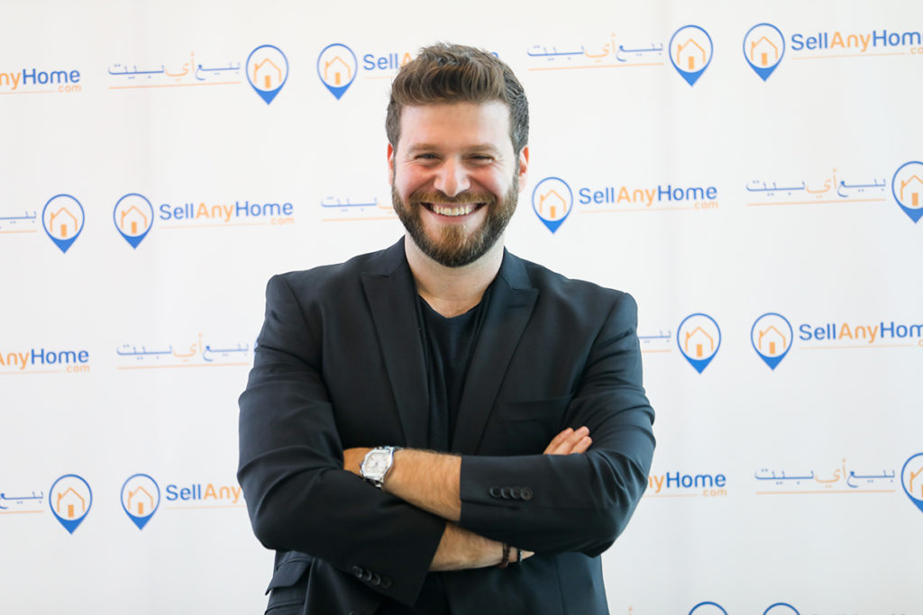 Omar Chihane standing on a backdrop of SellAnyHome